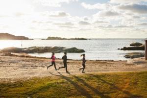 Skärgårdsleden hiking trail. Three persons hiking along the sea.